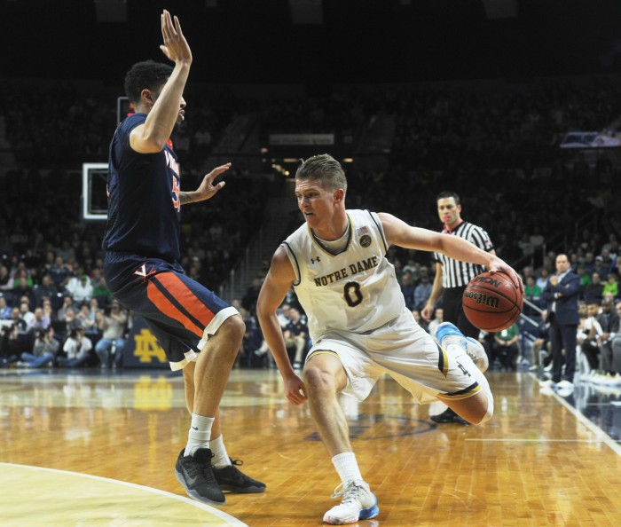 Irish sophomore Rex Pflueger drives towards the baseline during Notre Dame's 71-54 loss to Virginia on Tuesday at Purcell Pavilion.