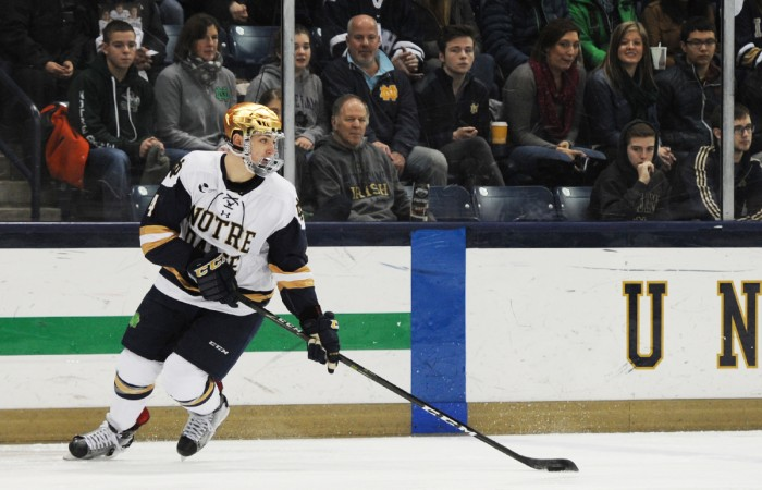 Irish sophomore defenseman Dennis Gilbert looks to move the puck during Notre Dame's 2-2 tie in overtime against New Hampshire on Jan. 20.