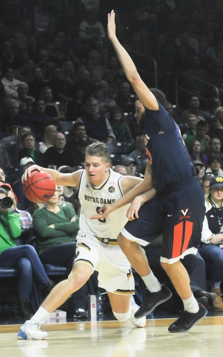 Irish sophomore guard looks to get by the Cavalier defender during Notre Dame's 71-54 loss to Virginia on Tuesday at Purcell Pavilion.