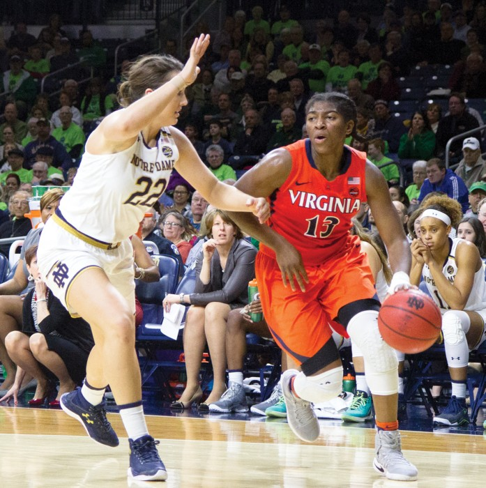 Irish freshman forward Erin Boley guards a driving Virginia player during Notre Dame's 82-74 victory over the Cavaliers on Sunday.= at Purcell Pavilion.