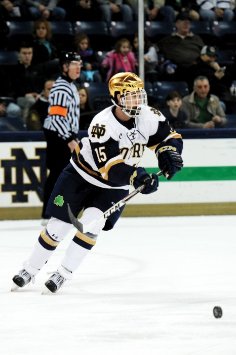 Irish sophomore Andrew Oglevie forward takes control of the puck during Notre Dame's 3-3 tie with New Hampshire on Jan. 20.