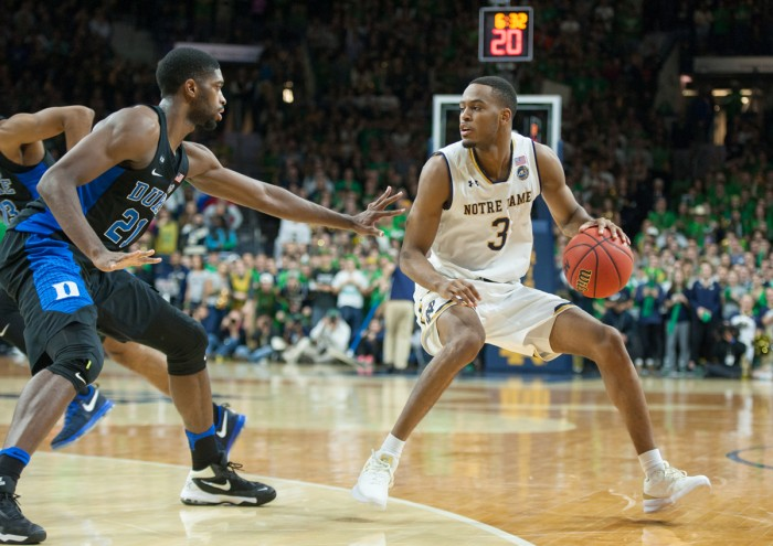Irish junior forward V.J. Beachem dribbles away from a defender during Notre Dame's 84-74 loss to Duke on Monday at Purcell Pavilion. Beachem paced the Irish with 20 points against the Blue Devils.