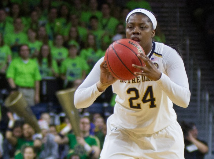 Irish sophomore guard Arike Ogunbowale looks to make a pass during Notre Dame's win over Virginia on Sunday at Purcell Pavilion.