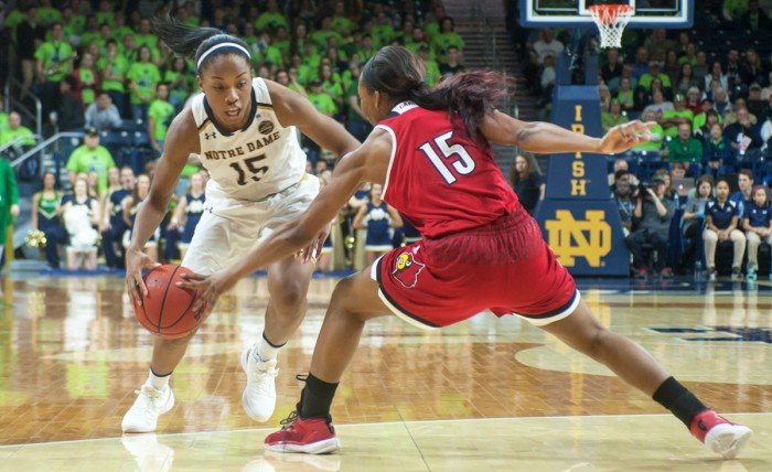 Irish senior guard Lindsay Allen drives past a Cardinal defender during Notre Dame's 85-66 win over Louisville on Feb 6 at Purcell Pavilion. Allen finished with 15 points, a season-high, and 8 assists.
