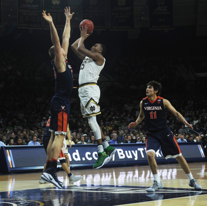 Irish junior forward Bonzie Colson shoots over a Virginia defender during Notre Dame's 71-54 loss to the Cavaliers on Jan. 24 at Purcell Pavilion. Colson paced the Irish with 27 points and 16 rebounds Tuesday.