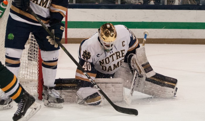 Irish junior goalkeeper makes a save during Notre Dame's 4-1 victory against Vermont on Feb. 4 at Compton Family Ice Arena.