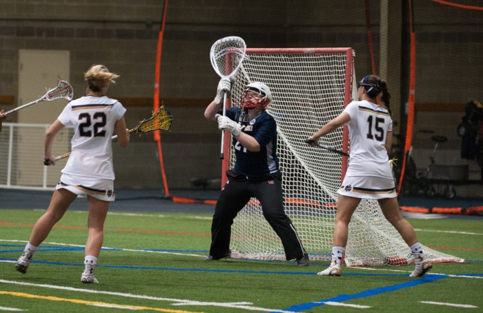 Irish senior attack Cortney Fortunato pressures the goalkeeper during Notre Dame's 24-9 victory over Detriot Mercy on Saturday at Loftus Sports Complex.