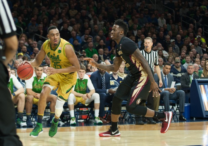 Irish junior forward Bonzie Colson looks to score against a Florida State defender during Notre Dame's 84-72 victory over the Seminoles on Saturday at Purcell Pavilion. Colson had a career-high 33 points in the game.
