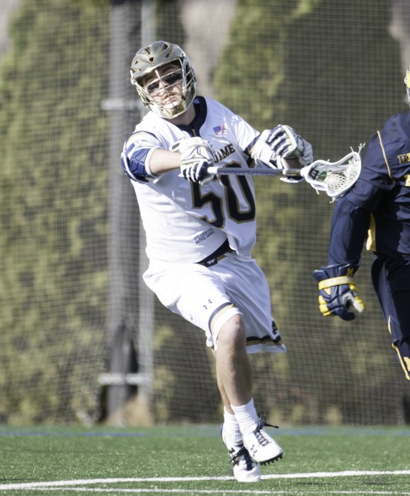 Irish sophomore Ryder Garnsey reaches to control the ball during Notre Dame's 16-5 victory over Michigan on Sunday at Arlotta Stadium.