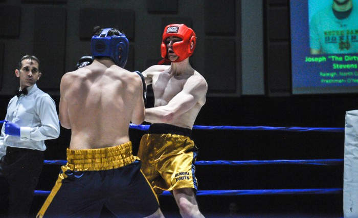 Senior captain and men's boxing president Jack Considine tangles with his opponent, Joseph Stevens, during the quarterfinal round of the 2015 Bengal Bouts on Feb. 18, 2015.