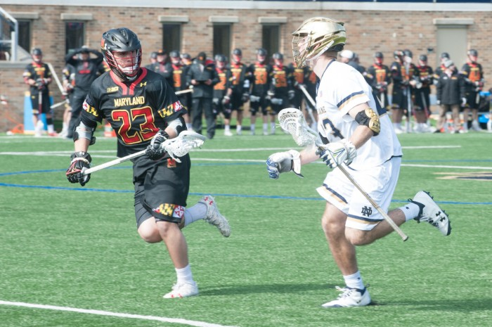 Irish senior midfielder Nick Koshansky looks to get by a defender during Notre Dame's 5-4 victory over Maryland on Saturday at Arlotta Field. After the win, the Irish are now ranked No. 1 in the country.
