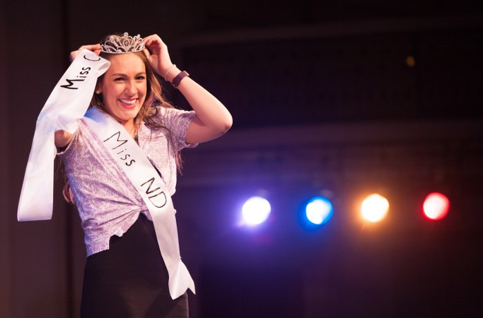 Senior Brittany Dymm replaces her Miss Cavanaugh sash with a Miss ND sash after she was crowned Miss ND 2017 Wednesday. A panel of four judges declared Dymm the winner after two rounds of competition.