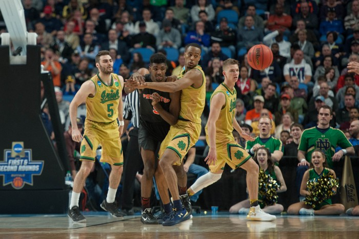 Irish players watch as the ball is passed to another Princeton player.