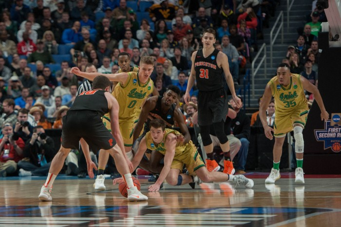 Irish players scramble over a loose ball.