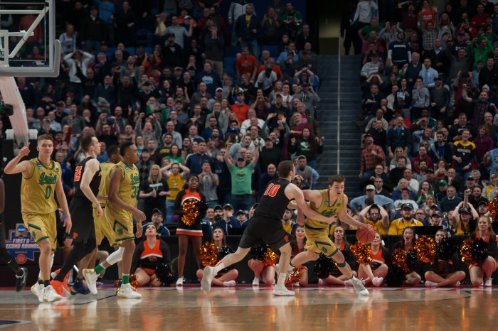 The stadium reacts as Irish senior guard Steve Vasturia secures the rebound on the missed shot that would have given Princeton the lead.