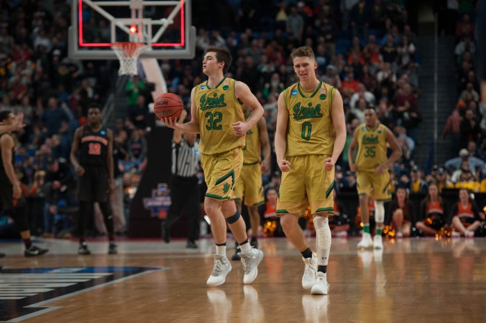 Irish sophomore guard Rex Pflueger reacts as Notre Dame secures the ball after Princeton missed the shot.