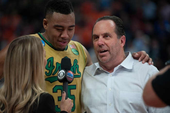Irish junior forward Bonzie Colson and head coach Mike Brey talk to a reporter following their 60-58 win over Princeton in the NCAA tournament Thursday.