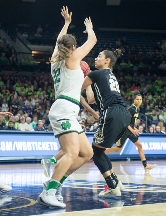 Former forward Erin Boley defends the paint against Boilermakers sophomore forward Dominique McBryde during Notre Dame's 88-82 overtime win over Purdue on March 19 at Purcell Pavilion. Boley announced Tuesday that she would be transferring to Oregon for the remainder of her collegiate career.
