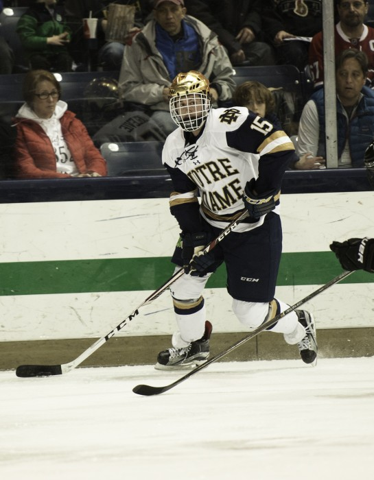 Irish sophomore forward Andrew Oglevie surveys the defense during Notre Dame's 5-2 win over Providence on March 11.