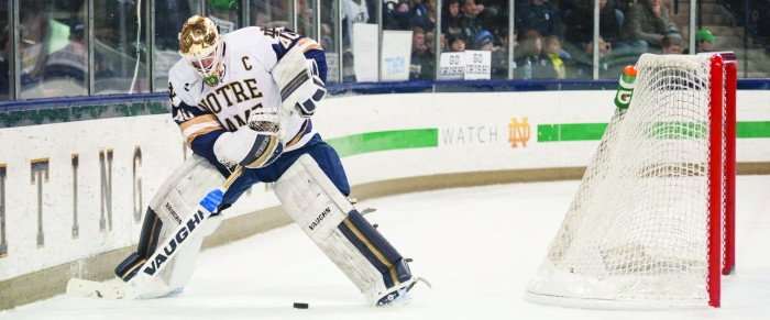 Irish junior netminder and team captain Cal Petersen attempts to gather control of a dump in during Notre Dame's Game 1 victory over Providence on March 11 at Compton Family Ice Arena.