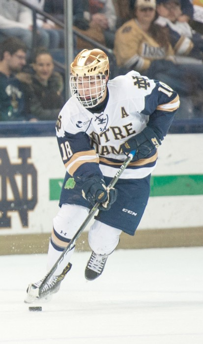 Irish junior forward Jake Evans breaks out during Notre Dame's 5-2 victory over Providence in Game 1 of the Hockey East quarterfinals.