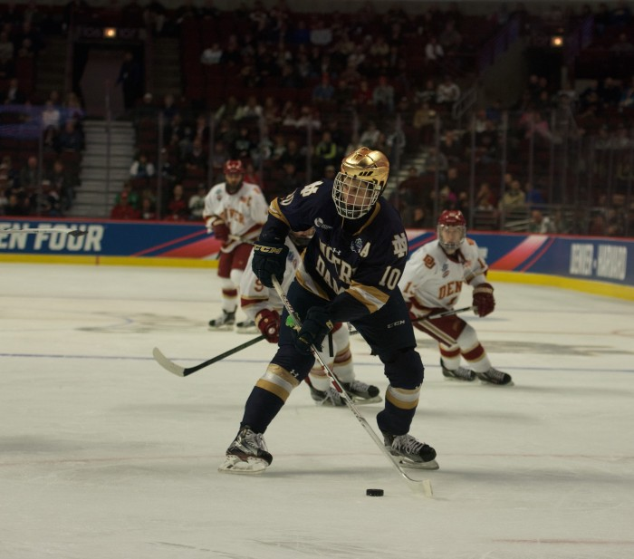 Irish junior forward Anders Bjork looks to move the puck during Notre Dame's 6-1 loss to Denver in the Frozen Four on April 6 at United Center. Bjork scored 109 points for the Irish during his career.