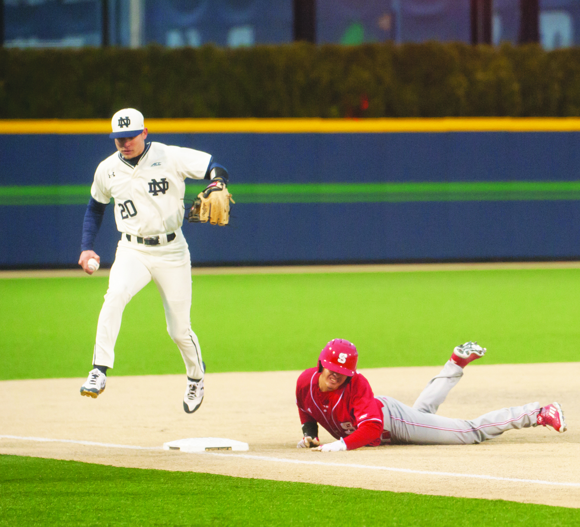 Irish senior third baseman Kyle Fiala tries to beat a runner to the base during Notre Dame's 4-1 win over N.C. State on March 31.