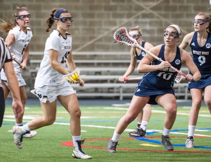 Irish senior attack Cortney Fortunato cradles the ball and surveys the field during Notre Dame's 24-9 win over Detroit on Feb. 11 at Loftus Sports Center. Fortunato scored six goals and added four assists in the win.