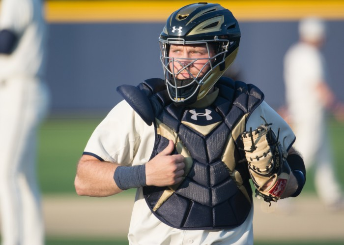 Irish senior catcher Ryan Lidge surveys the diamond during Notre Dame's 8-3 win over Toledo on April 12 at Frank Eck Stadium. Lidge has drawn 19 walks and has posted a .388 on-base percentage this season.