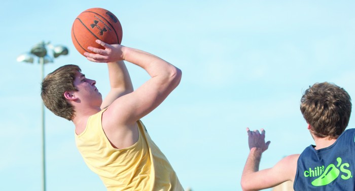 Senior Erich Jegier goes up for a shot during a tournament game.