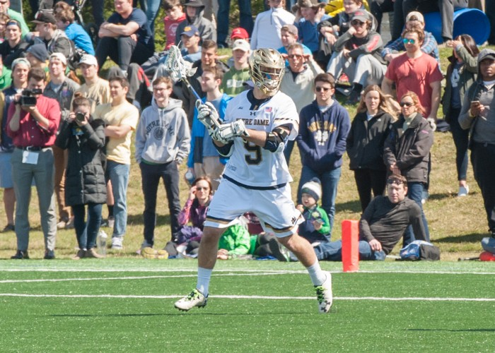 Irish sophomore midfielder Brendan Gleason looks for a teammate during Notre Dame's 11-10 loss to Syracuse on April 1 at Arlotta Stadium.