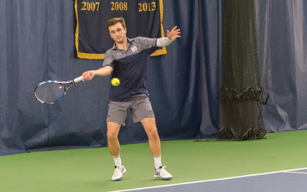 Irish senior Eddy Covalschi returns a shot during Notre Dame's 4-1 victory over Northwestern on Feb. 24 at Eck Tennis Pavilion.