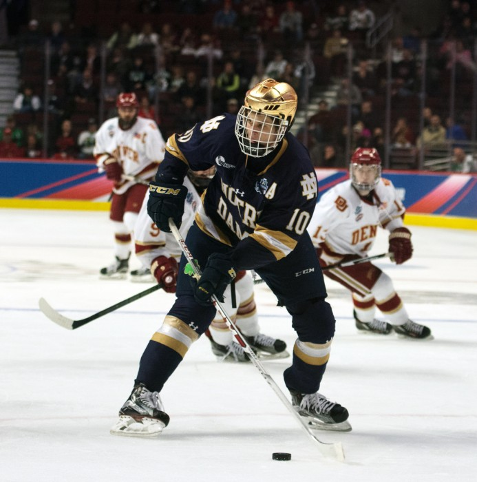 Irish junior forward Anders Bjork looks to pass the puck during Notre Dame's 6-1 loss to Denver in the Frozen Four on April 6 at the United Center in Chicago. Bjork took one shot in the game.