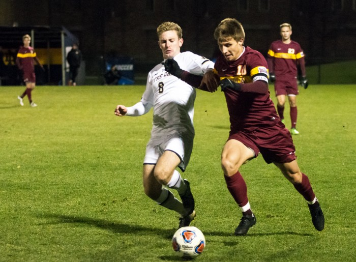 Irish junior forward Jon Gallagher goes in for a tackle on a Loyola player during Notre Dame's 1-0 win in the second round of the NCAA tournament on Nov. 20. Gallagher led the team in goals and assists.