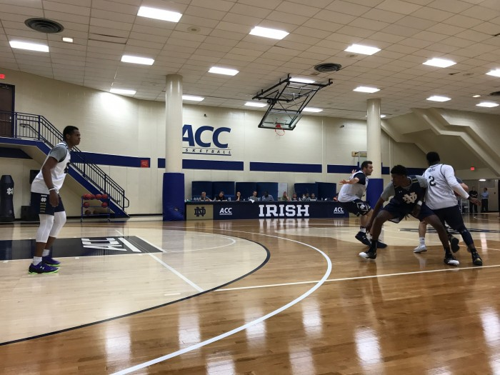 Freshman D.J. Harvey, left, hangs back to guard a pick-and-roll in a practice on July 6 at the JACC.