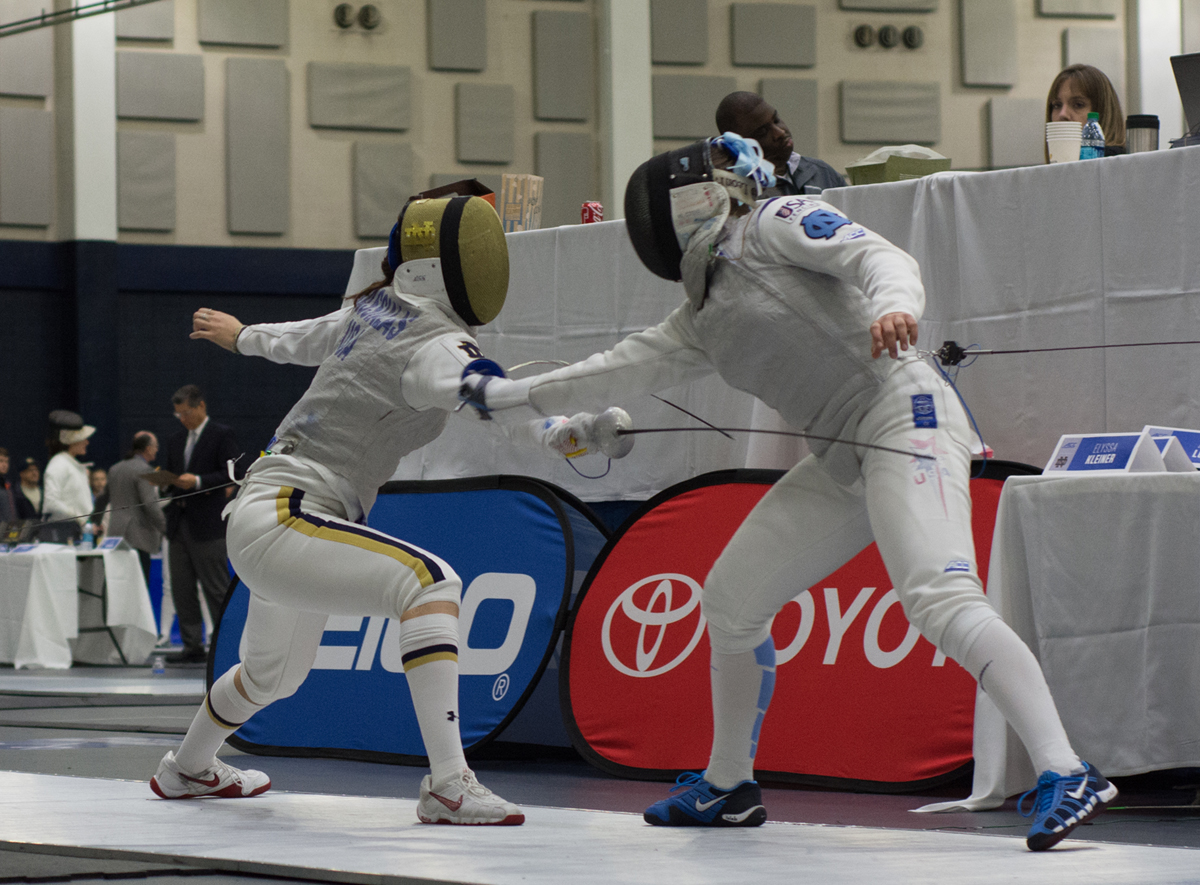 Irish junior foilist Sabrina Massialas lunges at her opponent during Notre Dame's victory at the ACC championships on Feb. 27, 2016, at the Castellan Family Fencing Center.