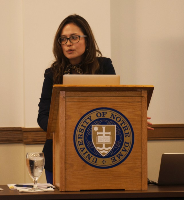 Thana Cristina de Campos, adjunct professor law at the University of Ottawa, lectures about ethical issues facing the pharmaceutical industry in the wake of the global health crisis Wednesday in Nanovic Hall.
