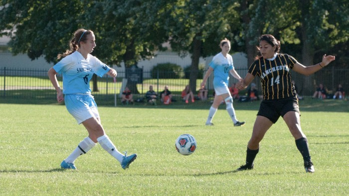 Saint Mary's senior defender Emily Lambert kicks the ball during the Belles' 4-1 win over Manchester on Sept. 2 at the Saint Mary's athletic fields.  It was the Belles' lone win of the season.