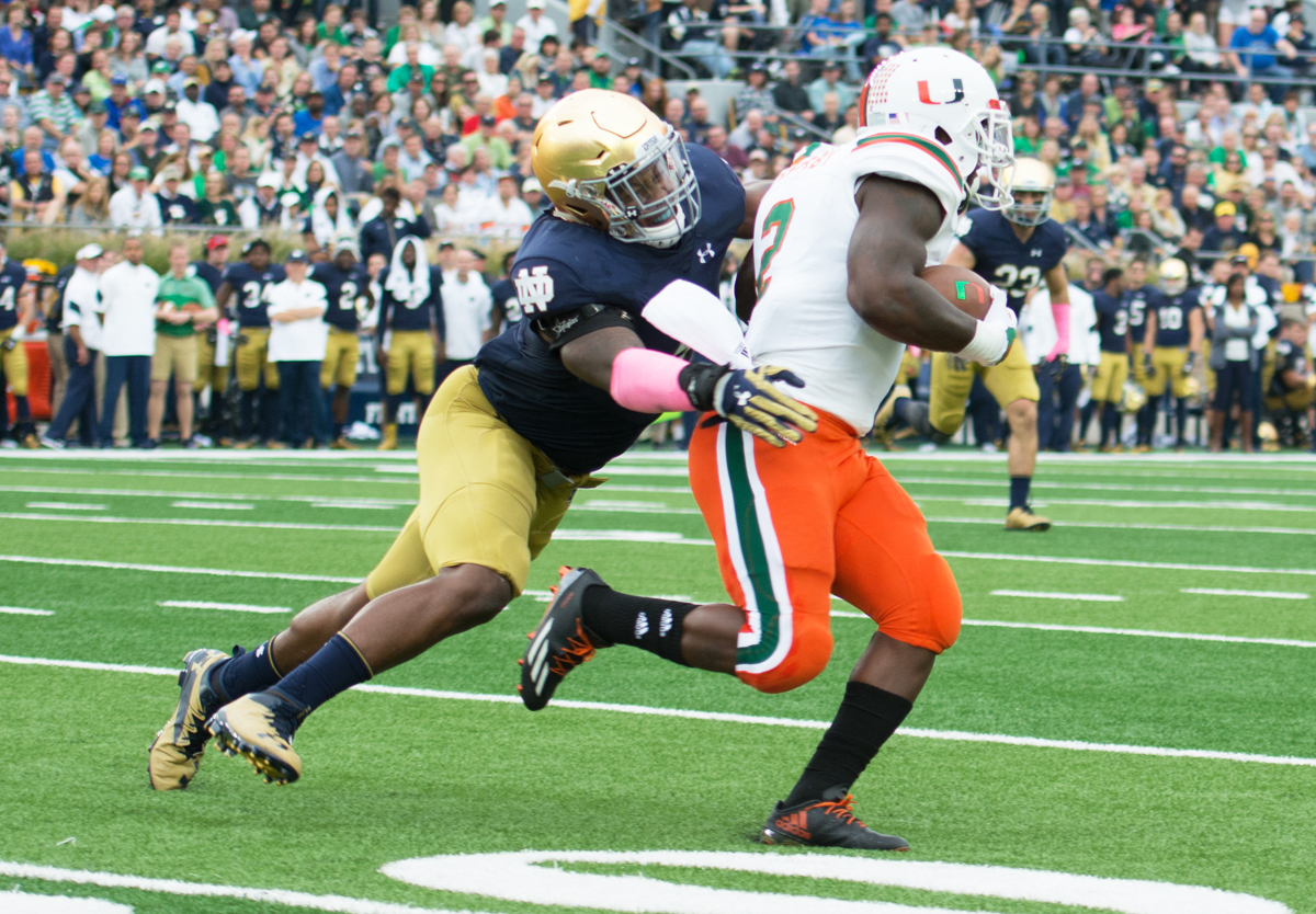 Irish senior linebacker Nyles Morgan tackles a Miami player during Notre Dame's 30-27 win over Miami (FL) on Oct. 29, 2016, at Notre Dame Stadium. The Irish landed three linebacker commits this summer, which will fill the holes left by the graduation of Morgan and seniors Drue Tranquill and Greer Martini after this season.