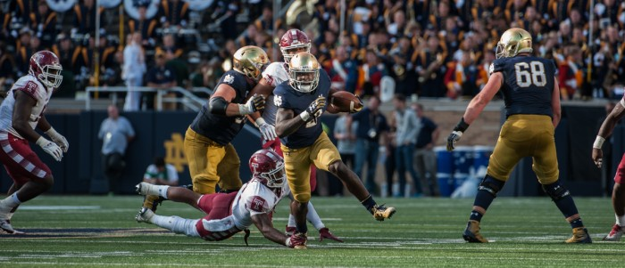 Irish junior running back Dexter Williams slips a tackle and heads upfield during Notre Dame's 49-16 win over Temple on Sunday. Williams tallied 124 yards and a touchdown on six carries in the Irish victory.