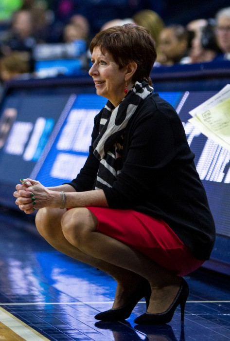 Irish head coach Muffet McGraw crouches during Notre Dame's 88-82 overtime victory over Purdue on March 19 at Purcell Pavilion