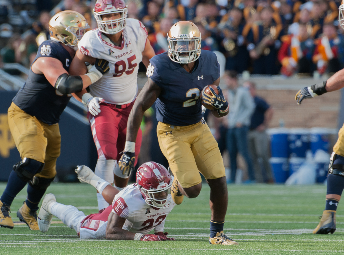 Irish junior running back Dexter Williams eludes a defender and looks upfield during Notre Dame's 49-16 win over Temple at Notre Dame Stadium. Williams had 124 yards on just six carries and one touchdown.