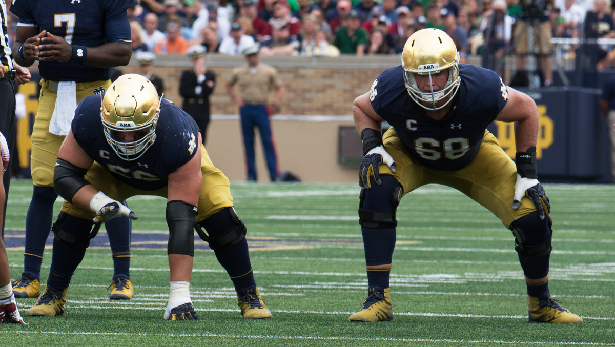 Irish offensive linemen senior Quenton Nelson, left, and graduate student Mike McGlinchey wait for the snap during Notre Dame's 49-16 win over Temple on Saturday at Notre Dame Stadium.