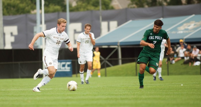 Irish senior forward Jon Gallagher dribbles the ball across the pitch during Notre Dame's 2-1 win over Cal Poly in double overtime on Aug. 27 at Alumni Stadium. Gallagher scored his first career hat trick during Notre Dame's 3-1 win over Boston College on Friday, scoring all three goals for the Irish and earning his first goals of the season.