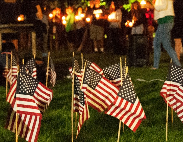 American flags adorn South Quad as student, faculty and community members gather for a candle-lit prayer service and Grotto procession led by Fr. Malloy, Notre Dame's president during 9/11.