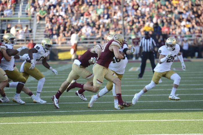 Irish senior captain Greer Martini pulls down a Boston College ball carrier in Notre Dame's 49-20 win over the Eagles on Saturday. Martini had 10 tackles in the game.