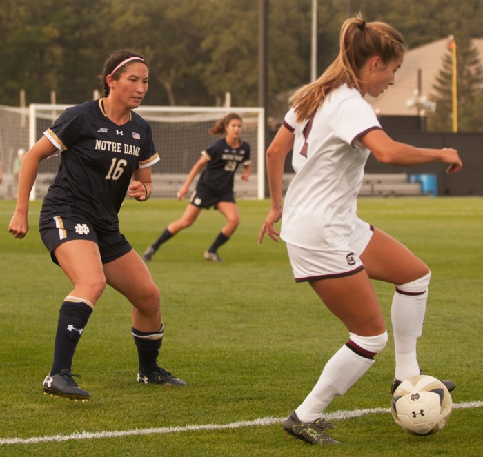 Irish graduate student midfielder Sandra Yu defends an opponent during Notre Dame's 1-0 double-overtime loss to South Carolina on Sept. 1 at Alumni Stadium.