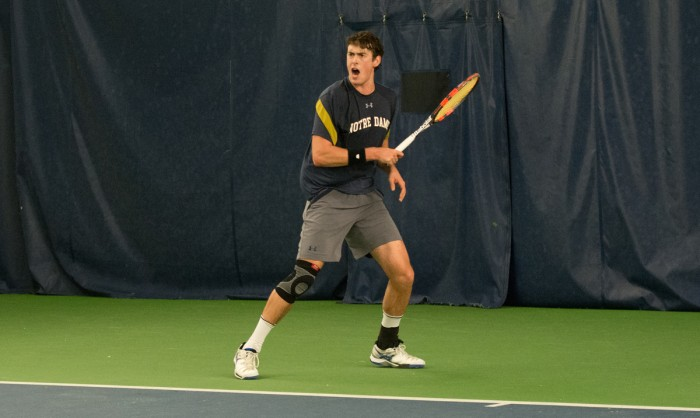 Irish junior Alex Lebedev reacts after scoring a point during a match against Northwestern on Feb. 24 at Eck Tennis Pavilion.