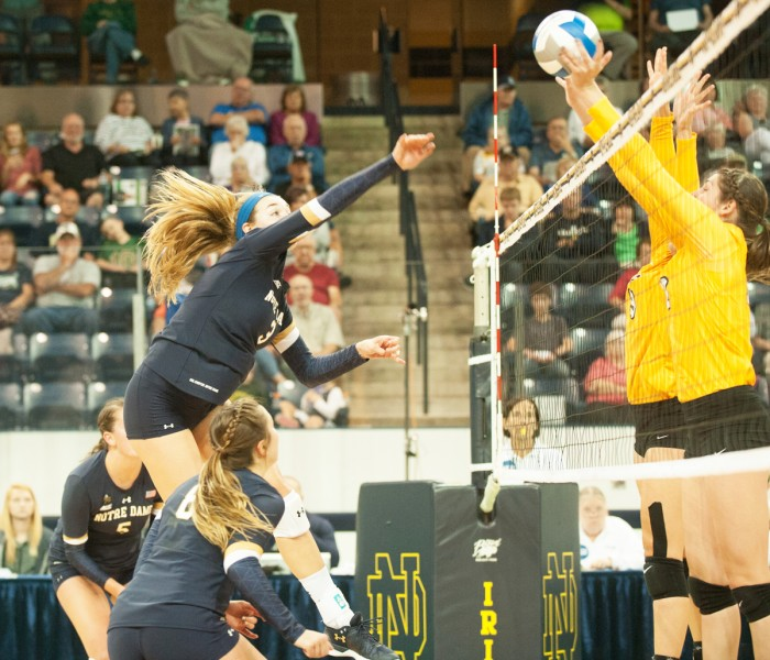 Irish senior middle blocker Sam Fry goes up for a kill during Notre Dame's 3-1 win over Valparaiso on Aug. 25 at Compton Family Ice Arena. Fry was name ACC Player of the Week this week.