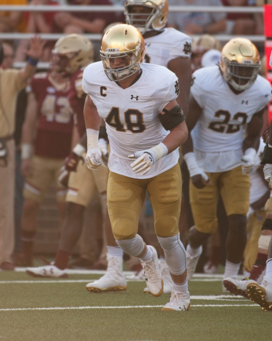 Irish senior linebacker Greer Martini takes the field during Notre Dame's 49-20 victory over Boston College in Chestnut Hill, Massachusetts.
